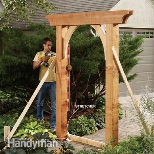 How to build a garden arbor simple diy woodworking project for Garden archway designs