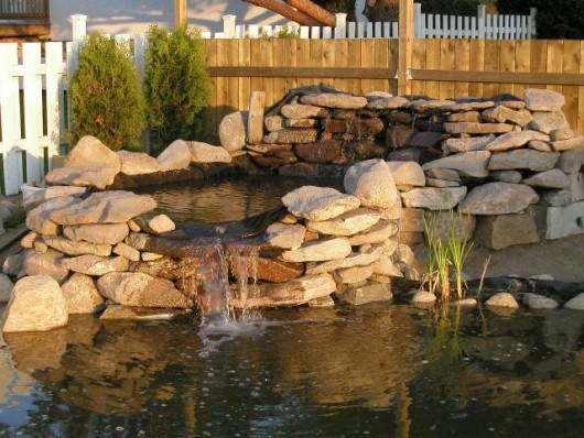 Diy garden ideas 10 garden waterfalls and inspiration for Building a large pond