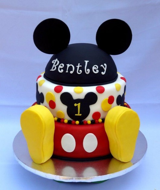 Mickey Mouse Holding Birthday Cake