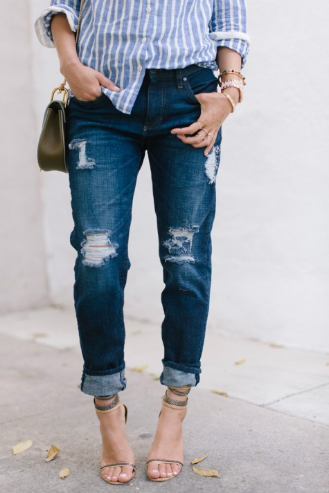 DIY ripped jeans distressed jean knee and thighs white threads visible