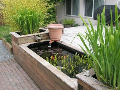Diy water garden ideas 54 pond garden ideas and design for Raised koi pond ideas