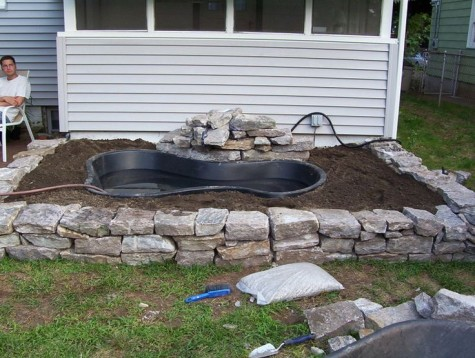 Diy water garden ideas 54 pond garden ideas and design for Raised fish pond designs